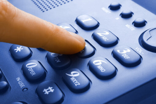 stock-photo-9224056-finger-with-green-phone-keypad_edit